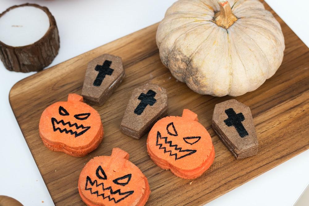 pumpkin on brown chopping board
