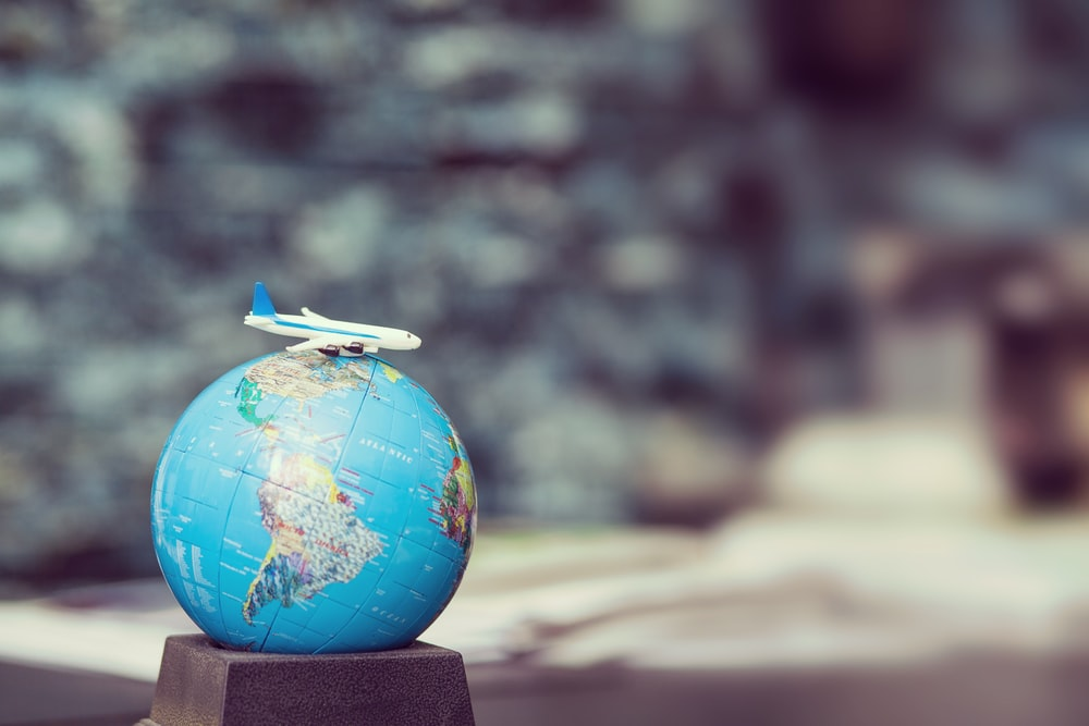selective focus photo of desk globe
