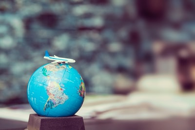 plane toy over a world globe