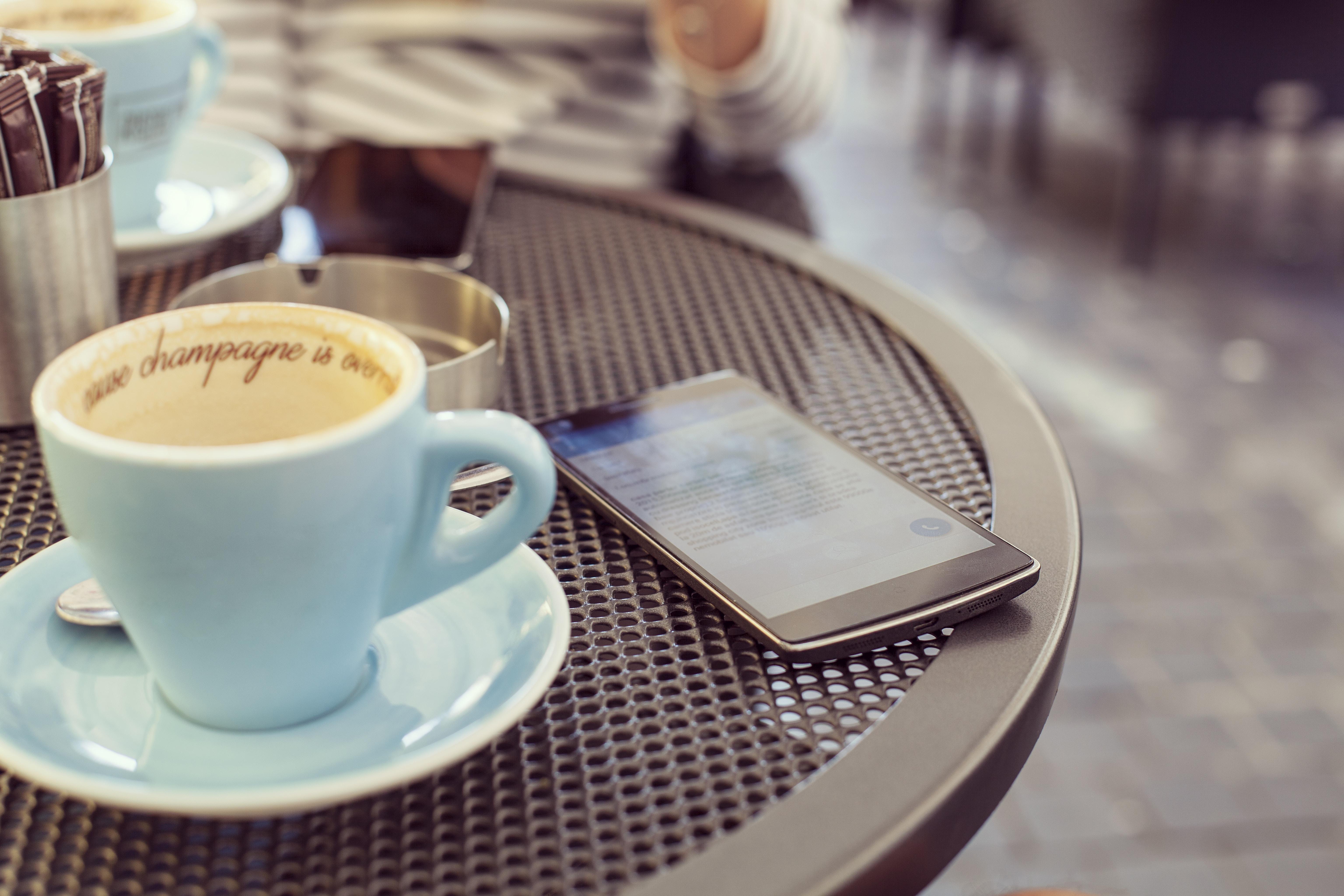 black Android smartphone on black steel table