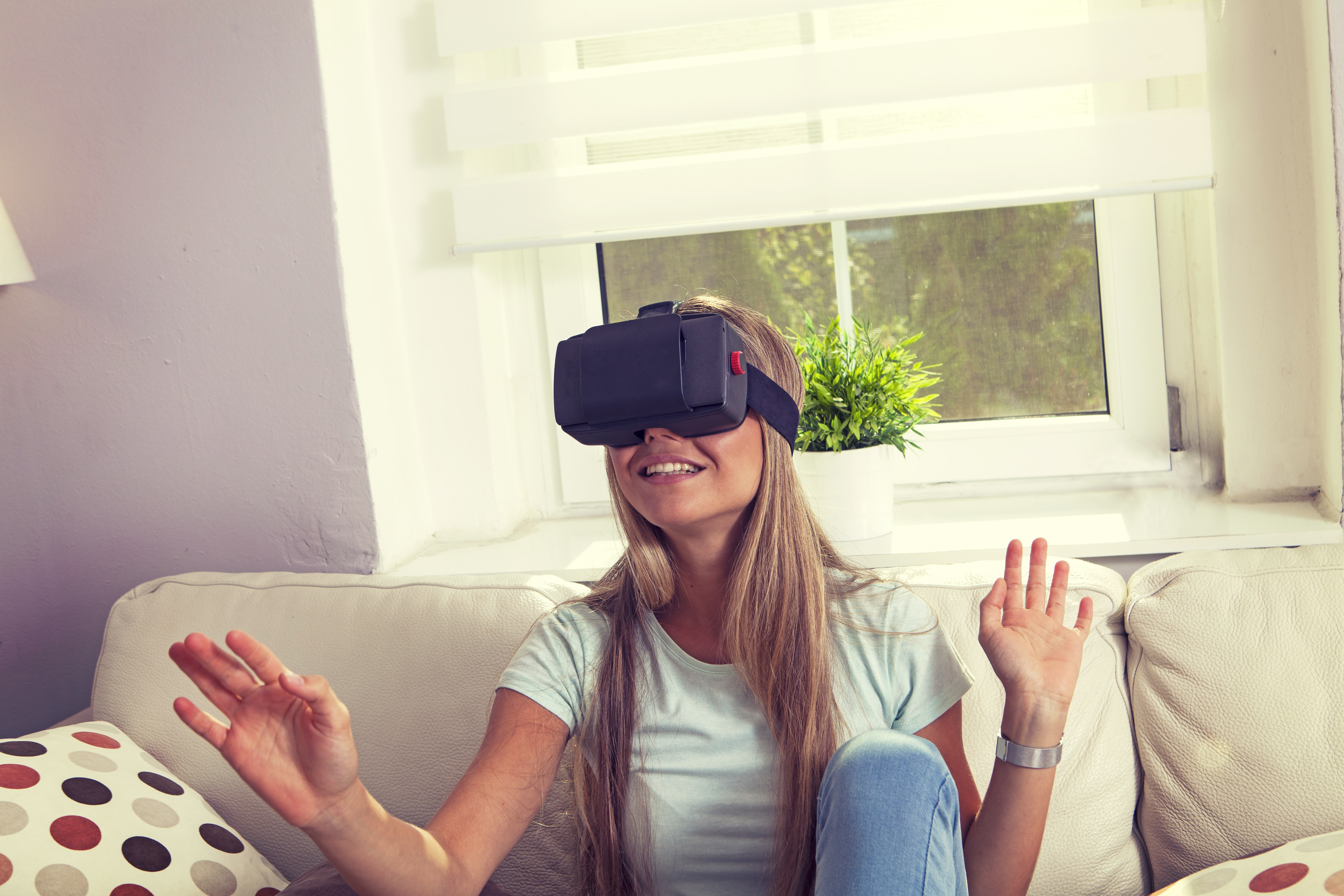 woman in white crew-neck t-shirt using virtual reality