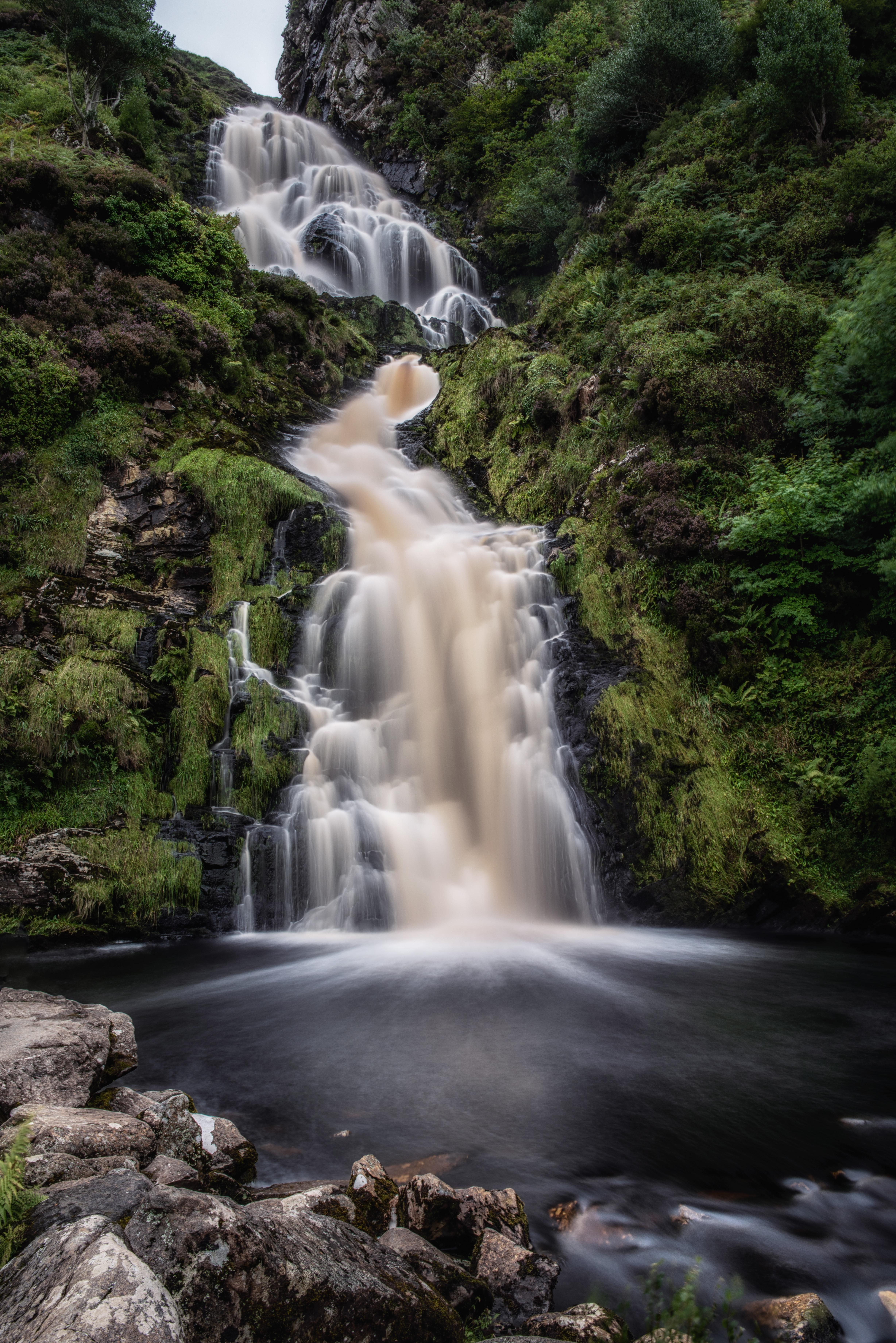 shallow focus photo of waterfalls