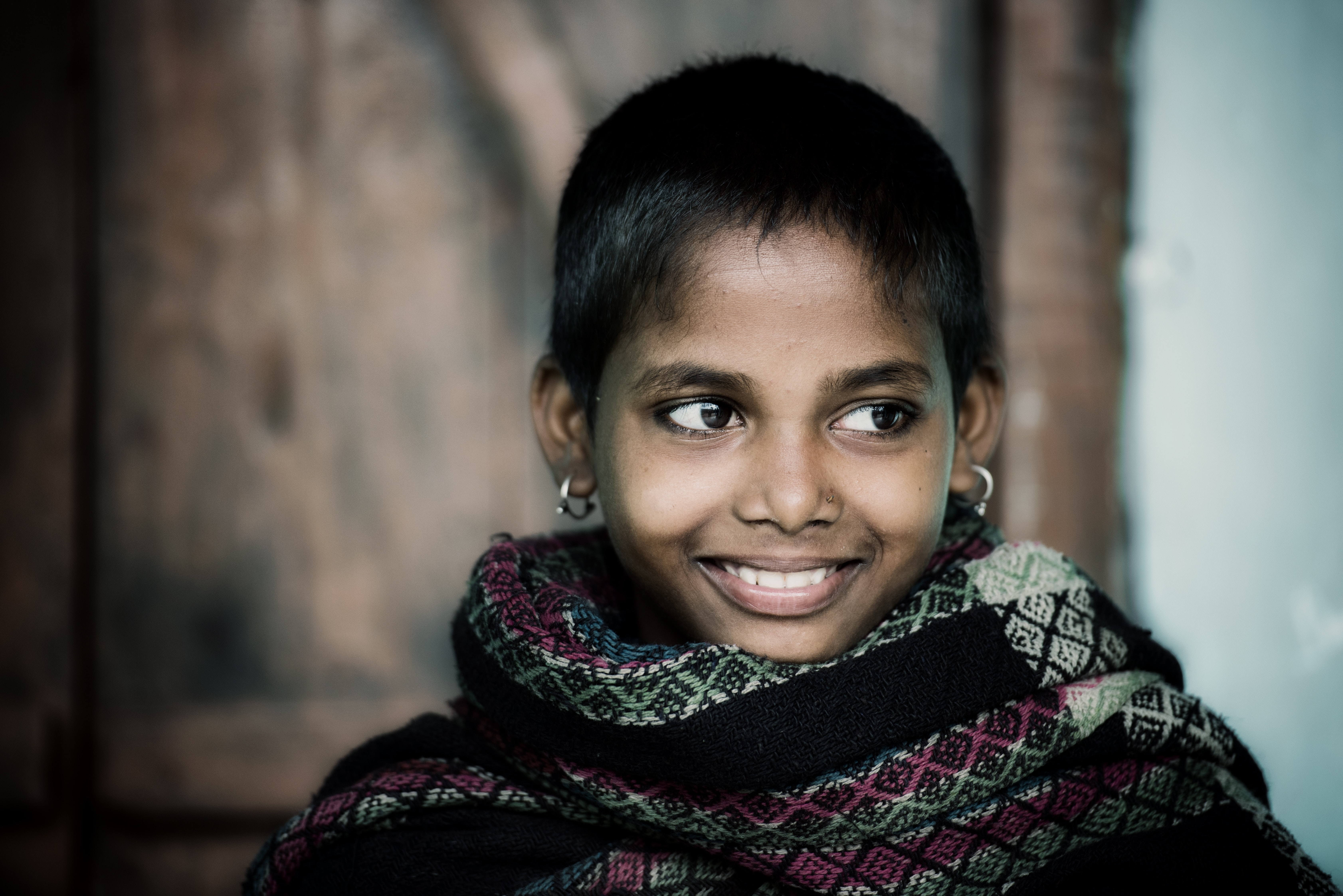 selective focus photography of girl while smiling