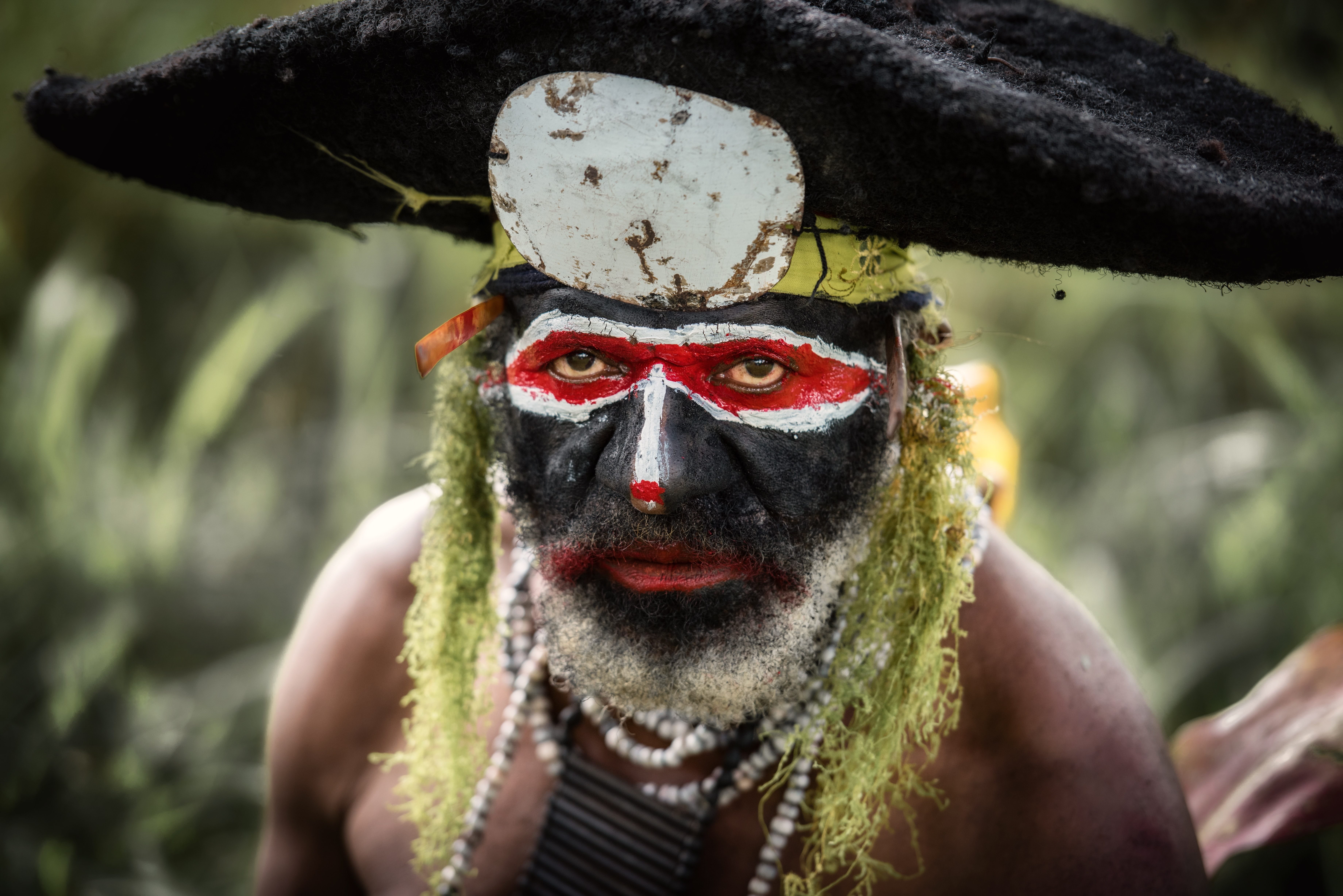 tribal man with mask