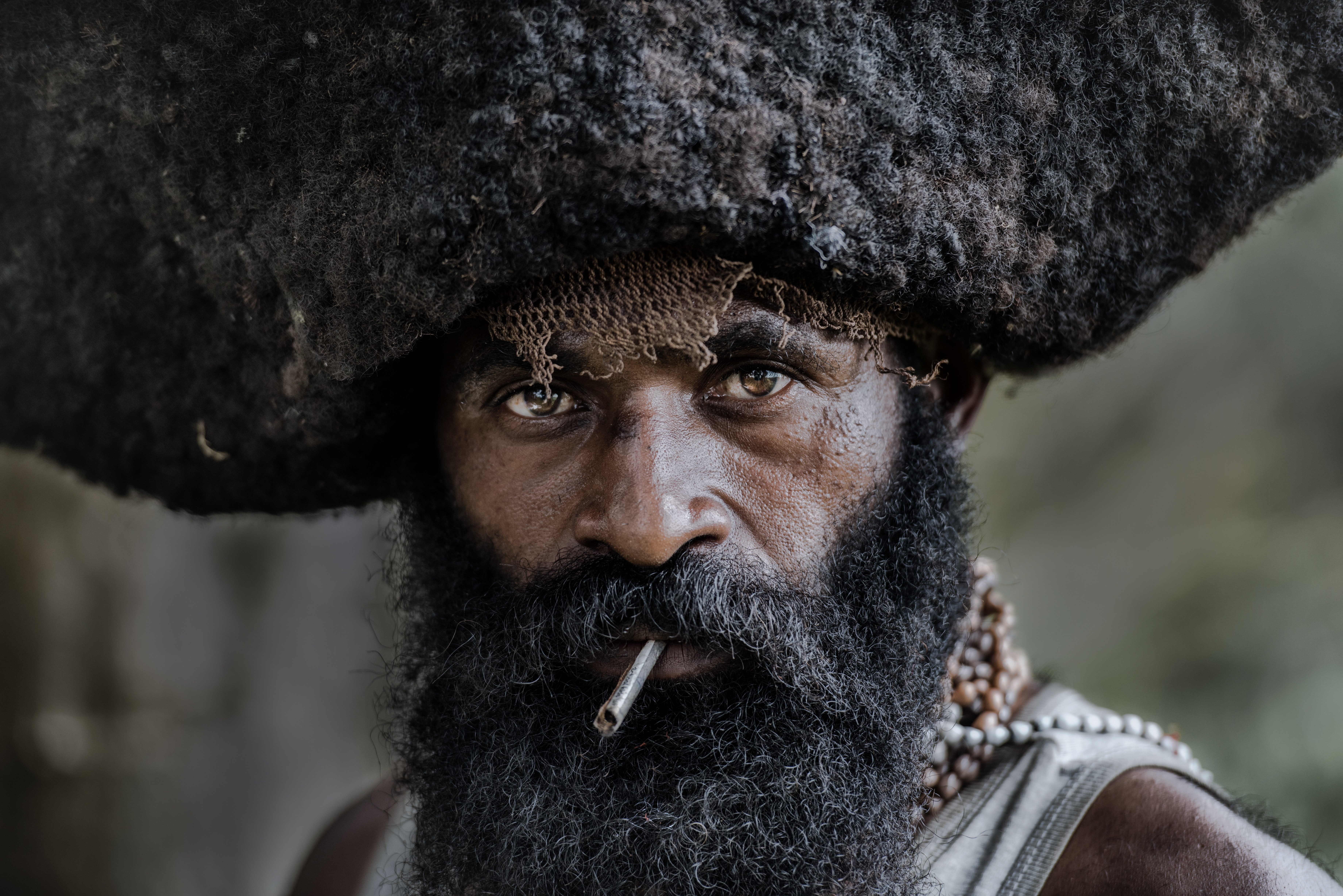 shallow focus photo of man smoking