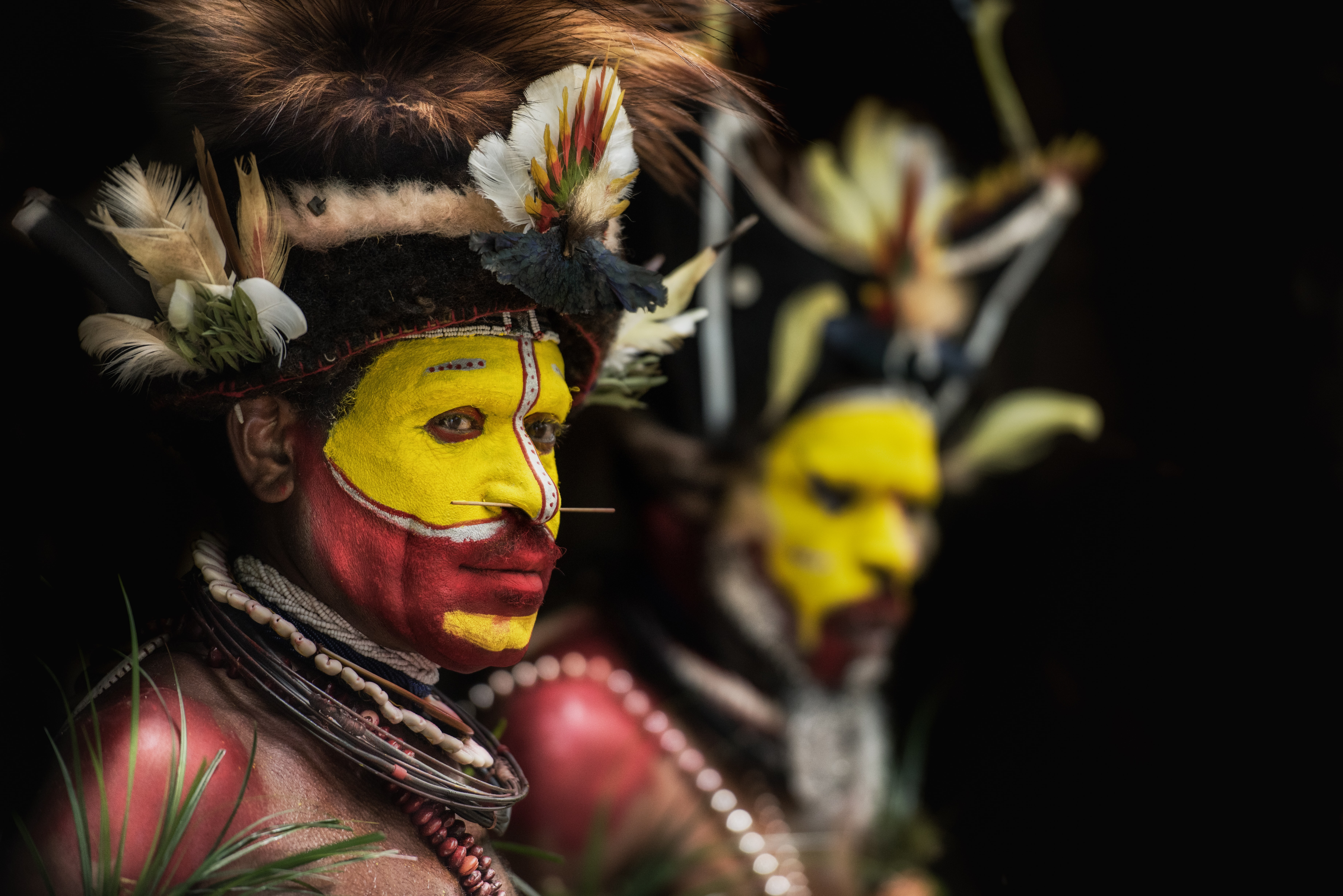 man with yellow and red face paints
