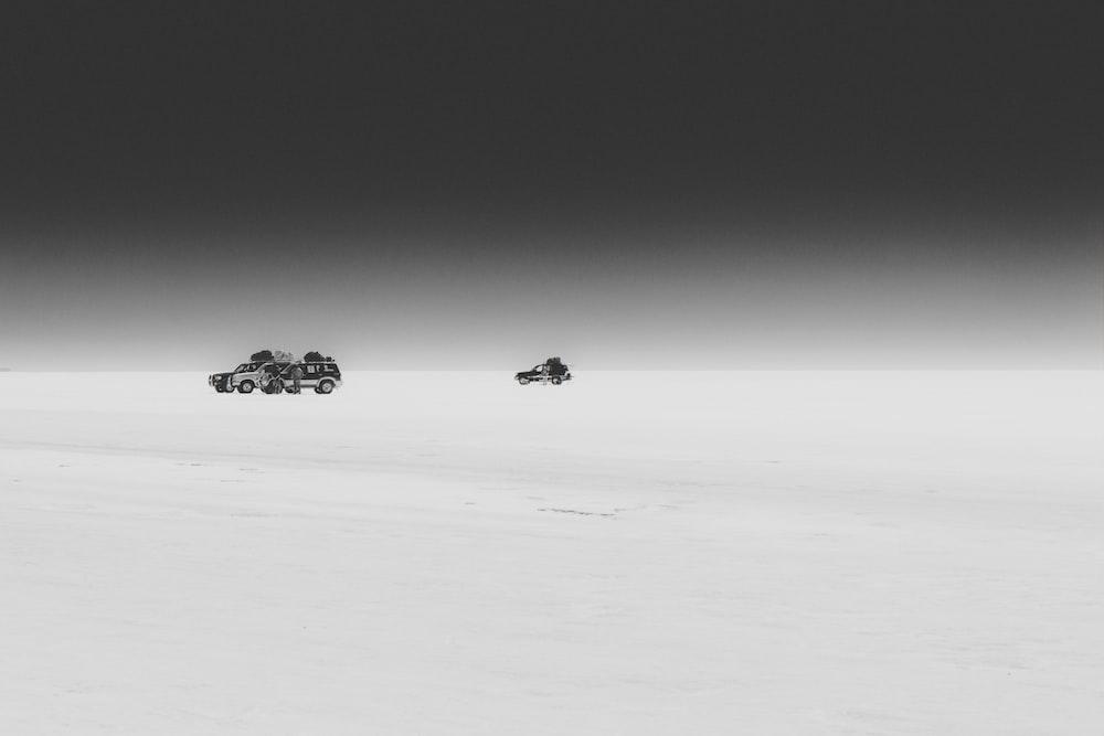 three vehicles on sand