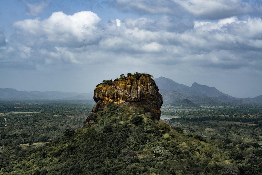 brown rock mountain under cloudy sky