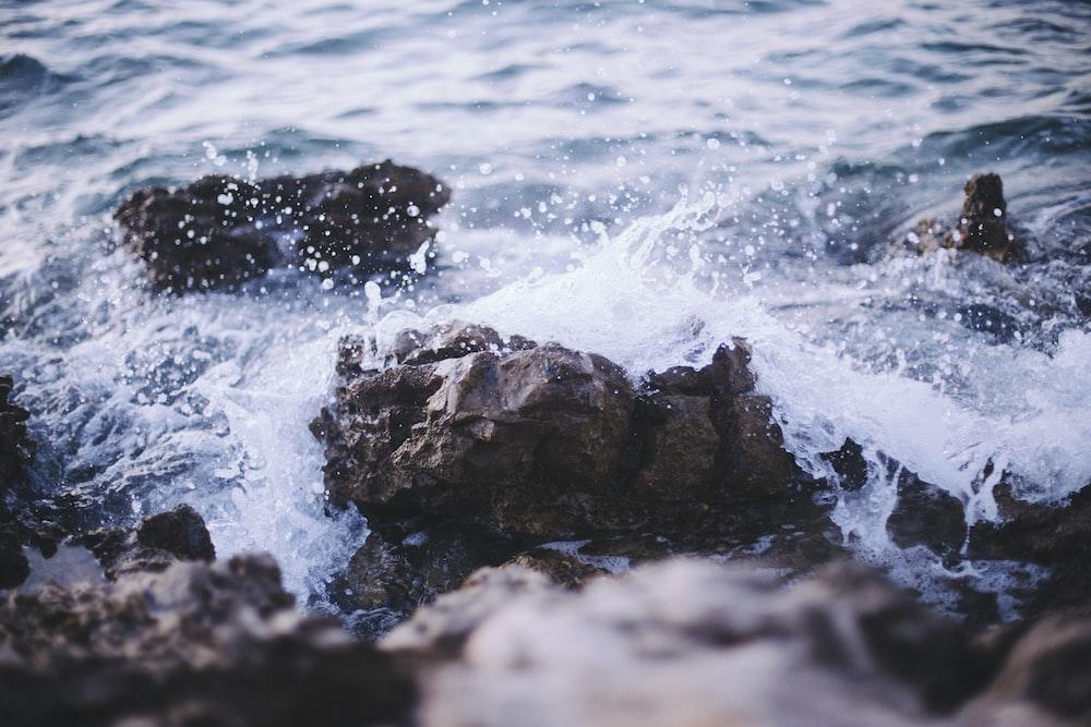 water splash on rock