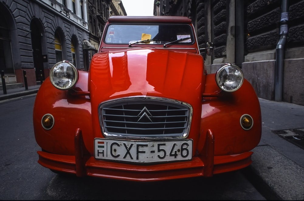 red Citroen car parked on road