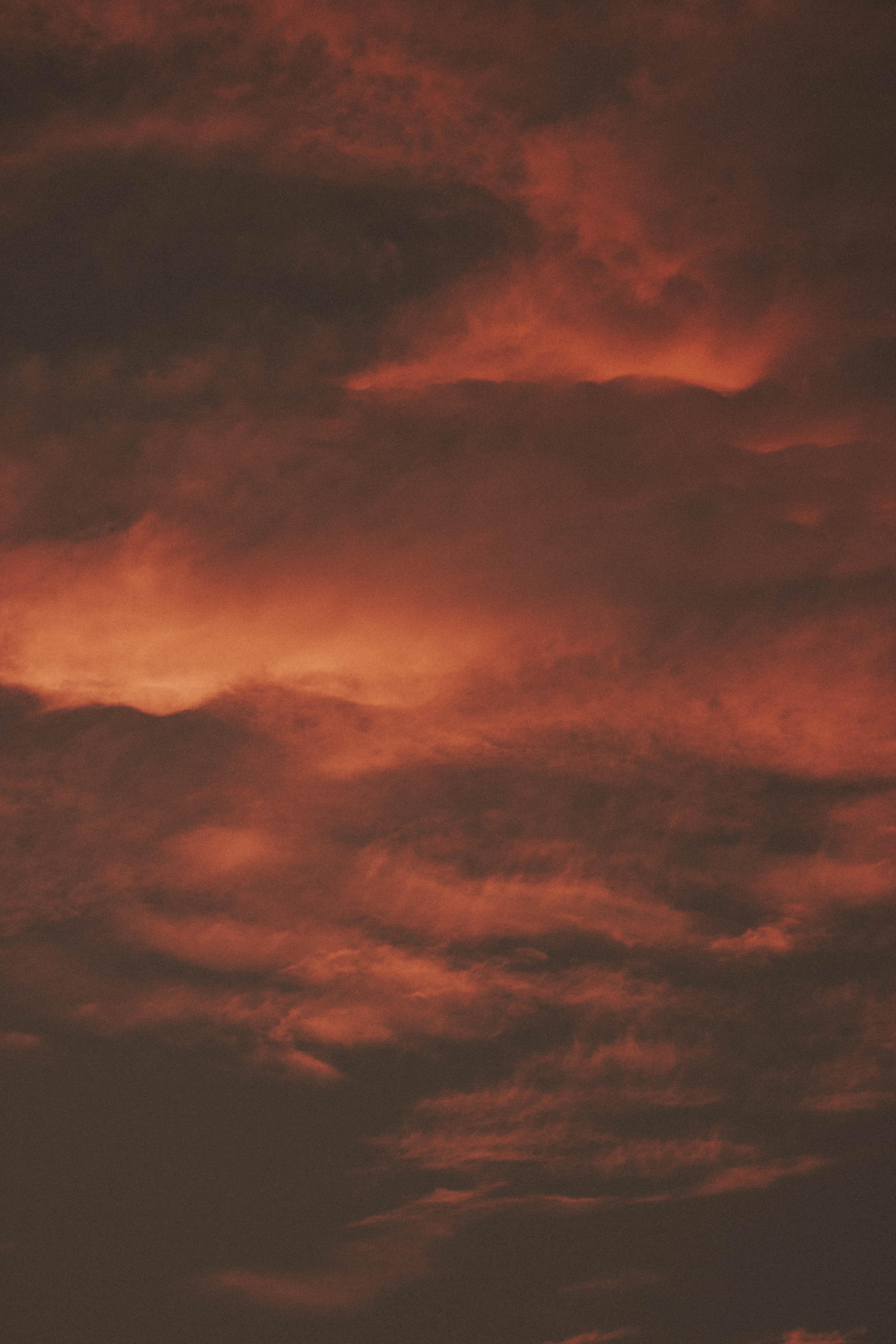 maroon cloudy sky