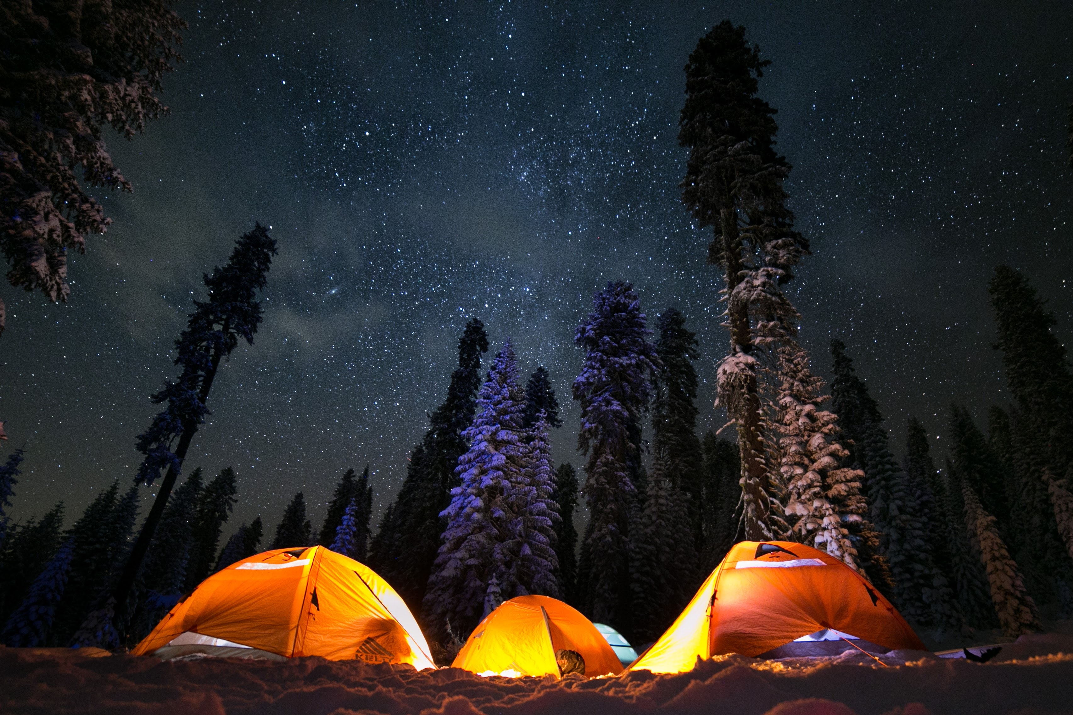 three tents under stars