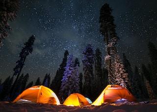 three tents under stars