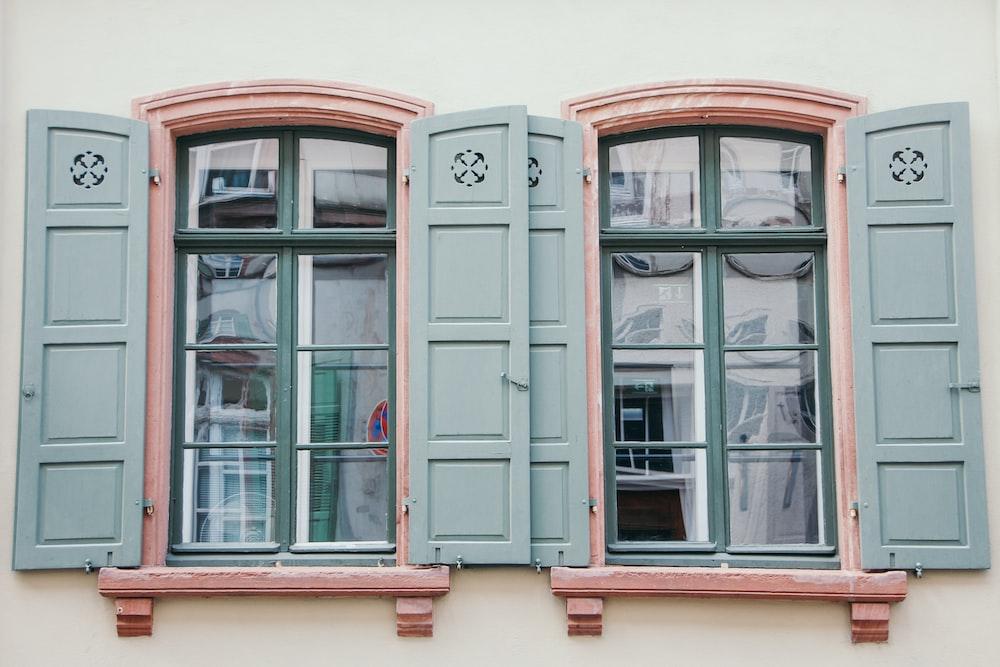 blue wooden window panes