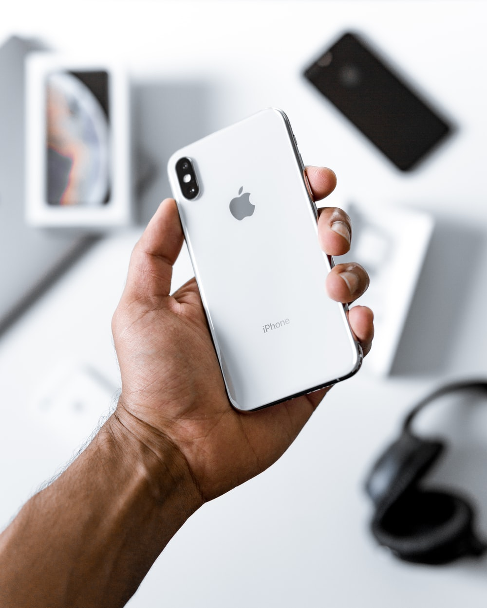 person holding silver iPhone X