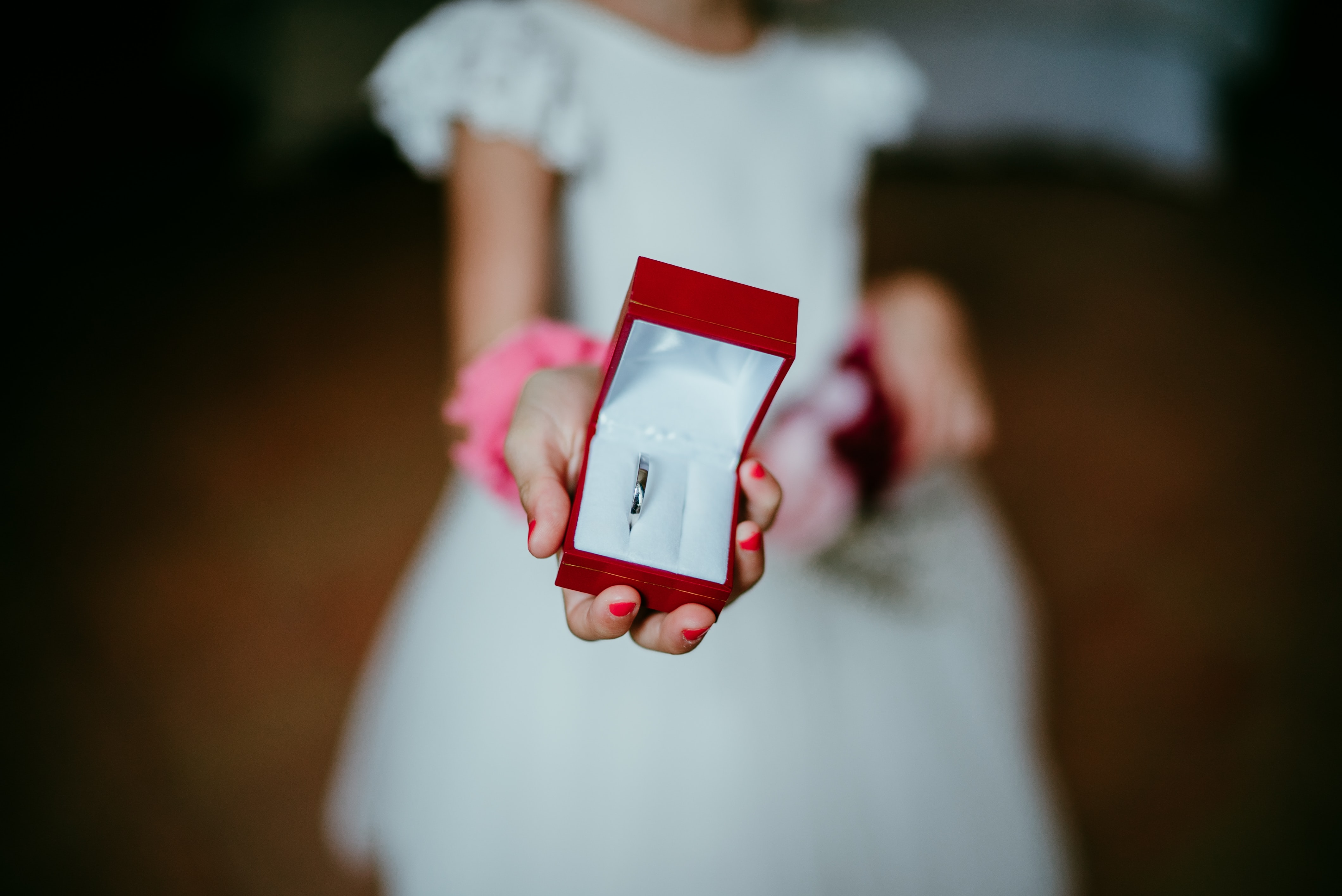 kid holding red ring box