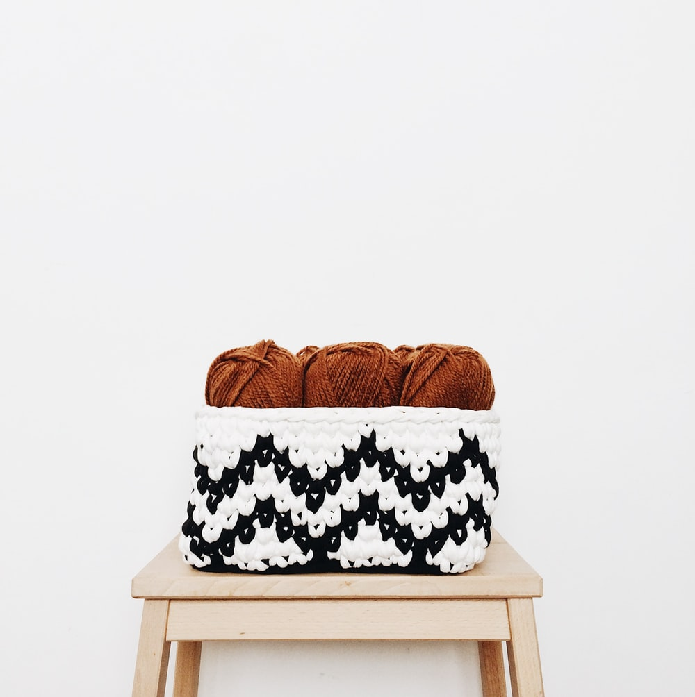 brown yarns in basket