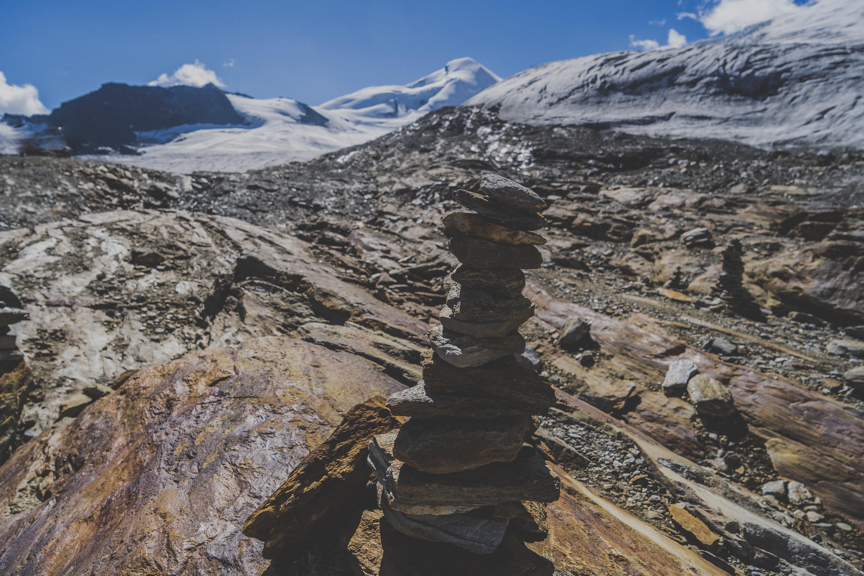 stone cairn on mountain peak
