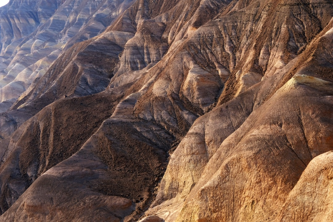 Horizontal patterns through the rocks appearing from the iconic Zabriskie Point view in Death Valley