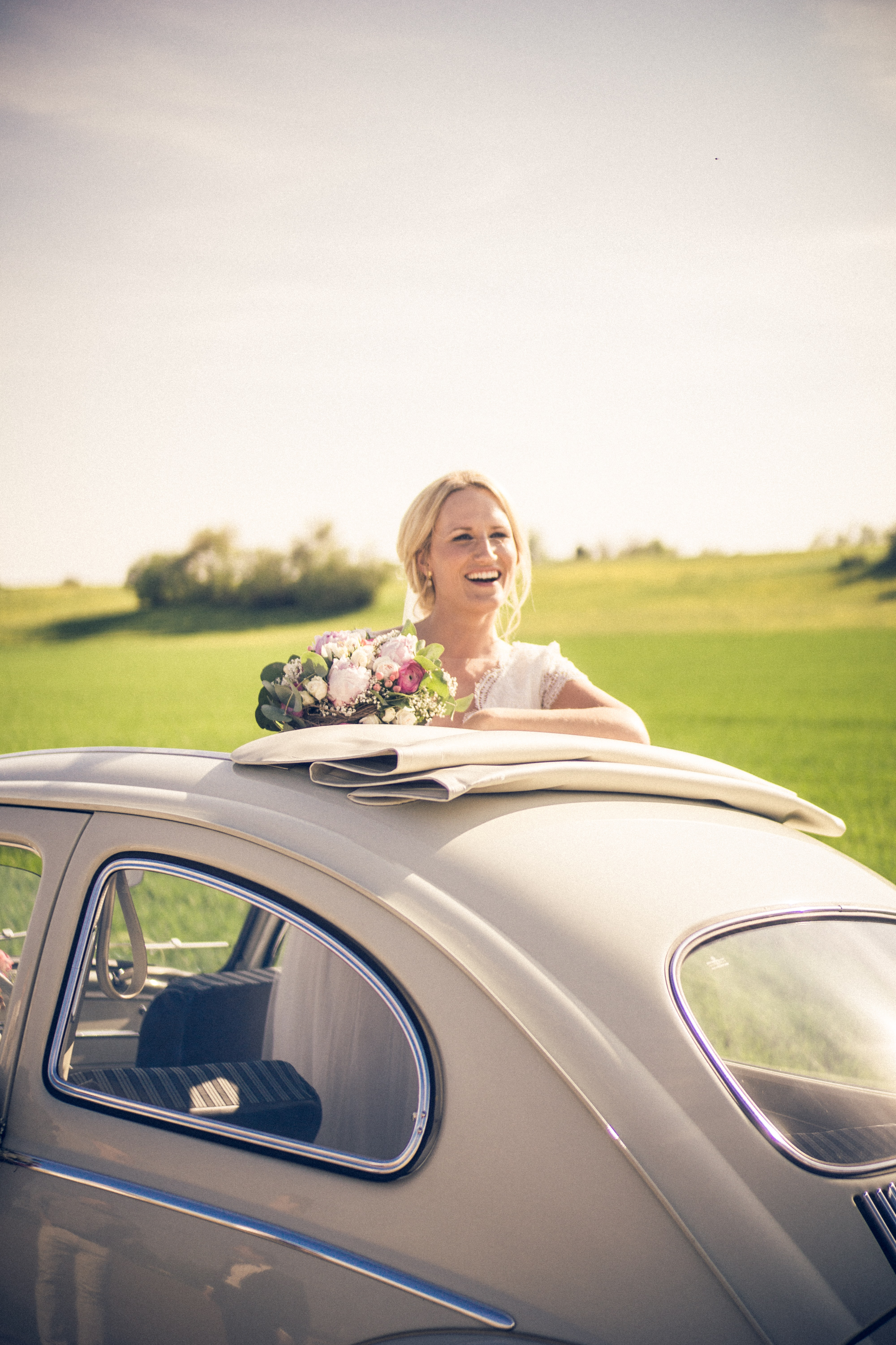 woman in wedding gown standing on white coupe