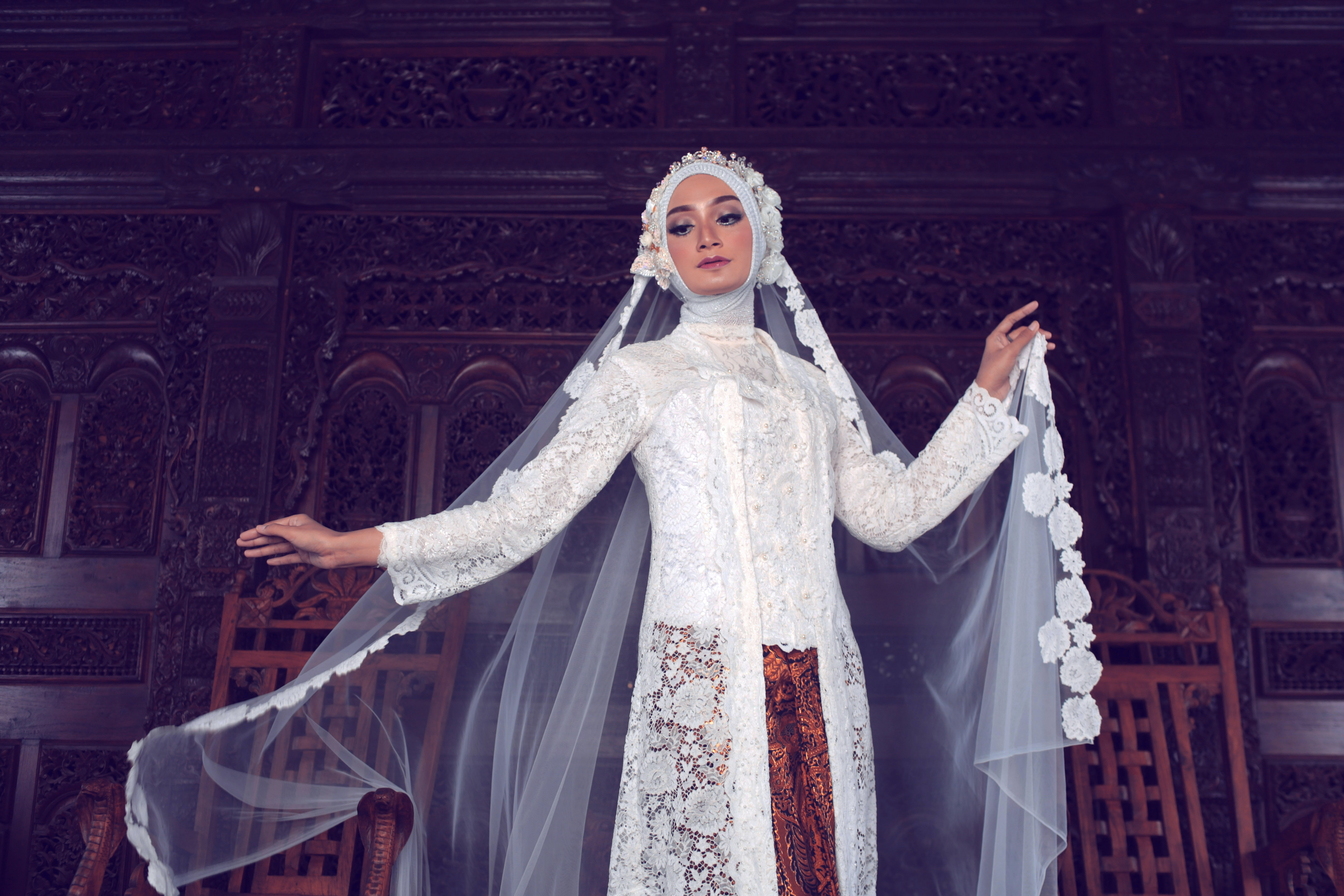 woman wearing white wedding gown with veil