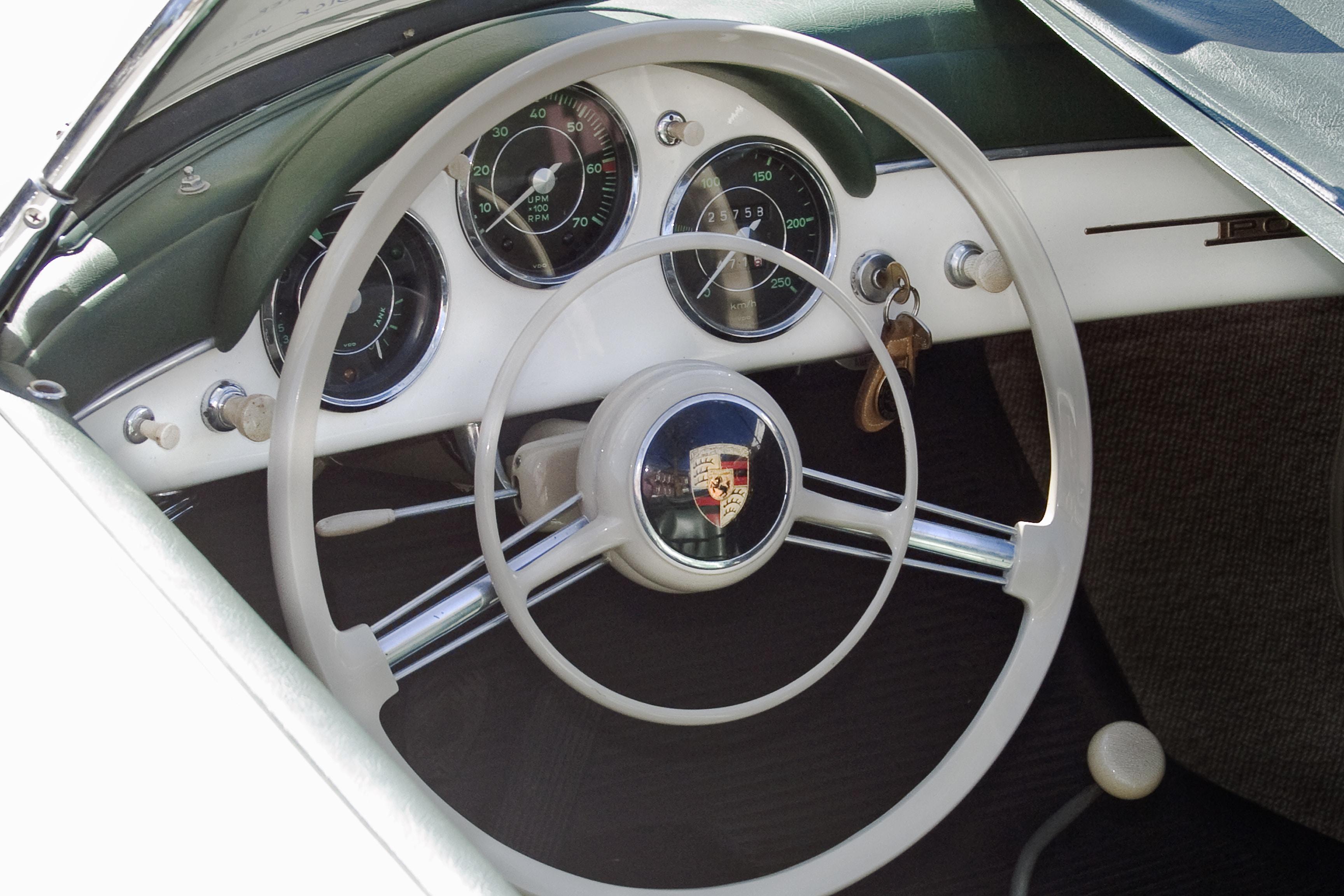 silver Porsche steering wheel