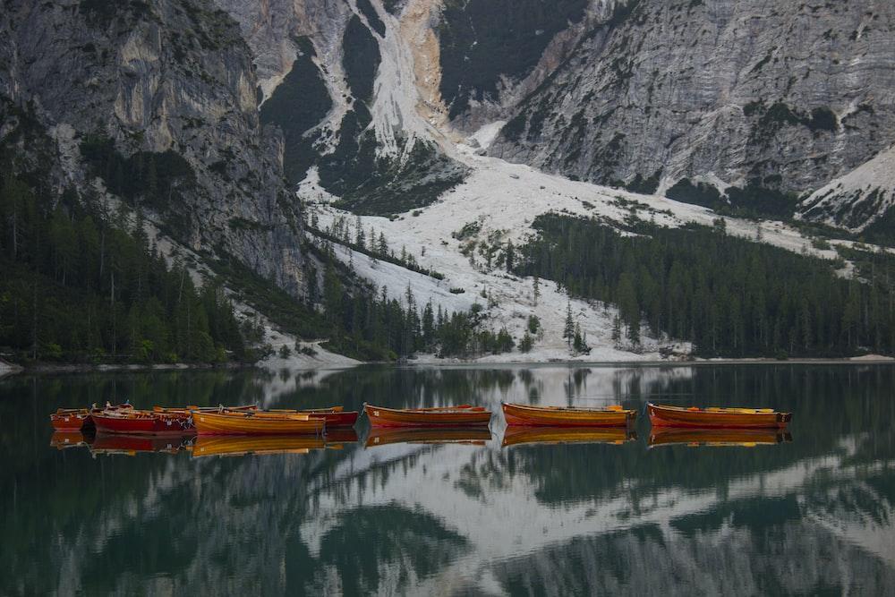 orange canoe on body of water
