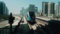 blue and black train on rail