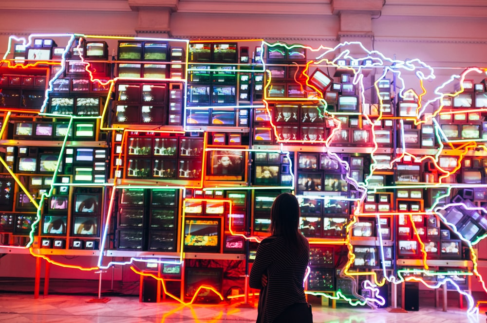 woman looking at monitors with light decor
