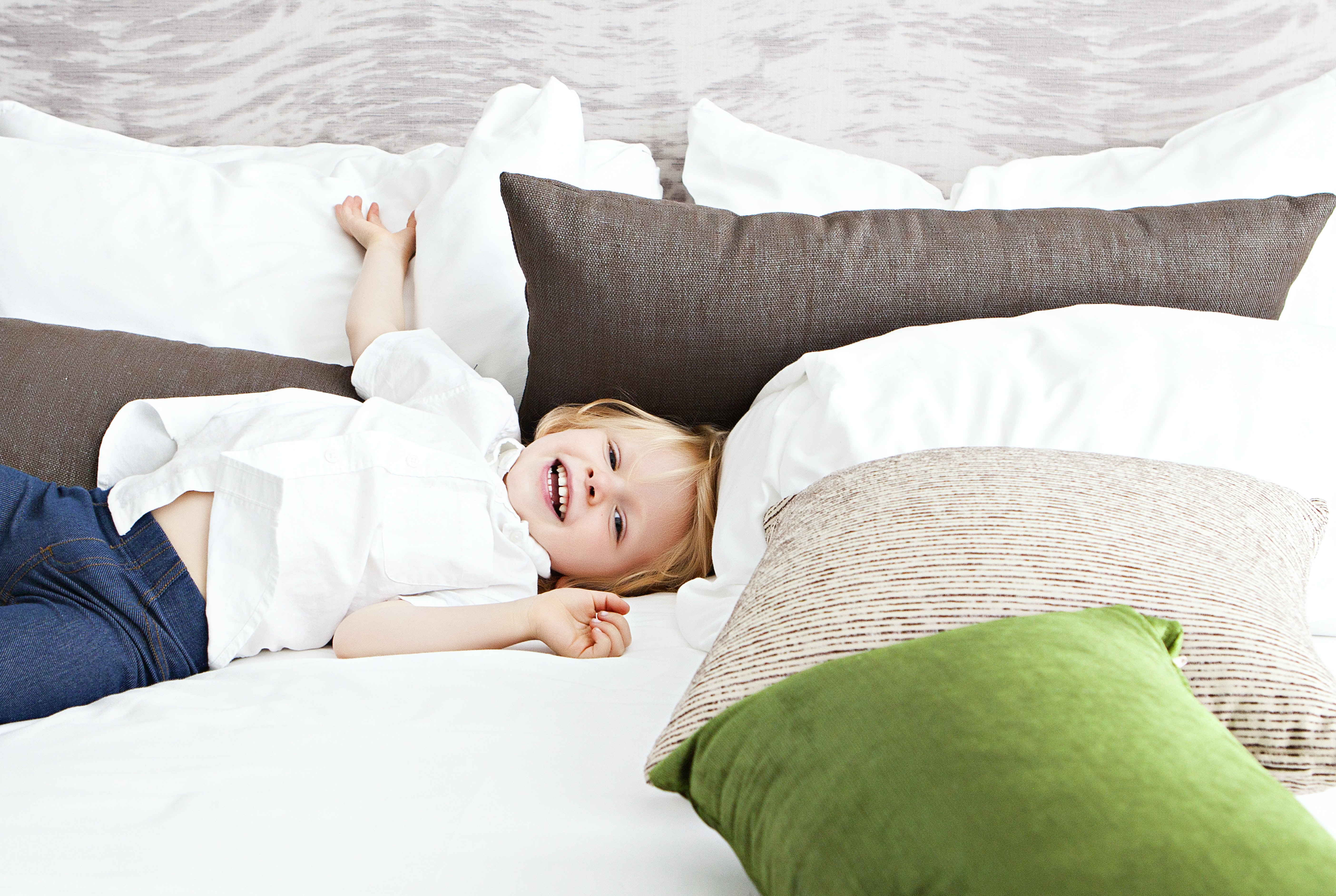 boy lying on bed
