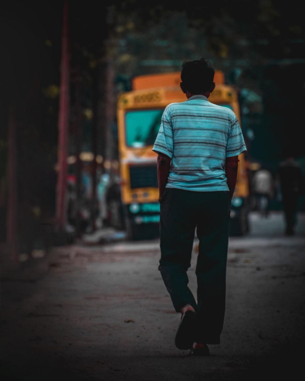 man walking towards the truck