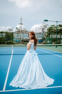 woman standing on tennis court
