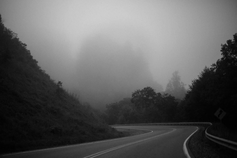foggy sky under asphalt road