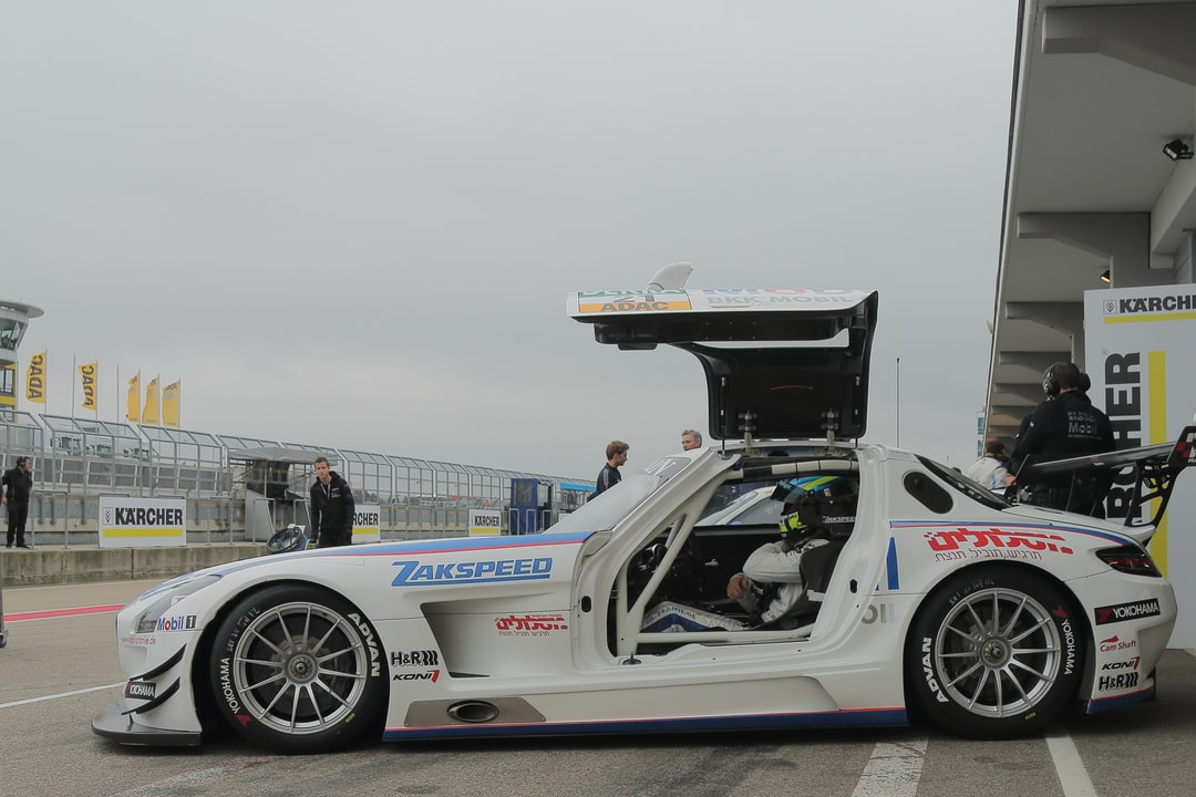 This shot was taken on the pit lane of the Sachsenring in 2014 at the ADAC GT-Masers racing event. A seldom moment, without working mechanics in front of the car.  Racing Team name: BKK Mobil Oil Racing Team Zakspeed