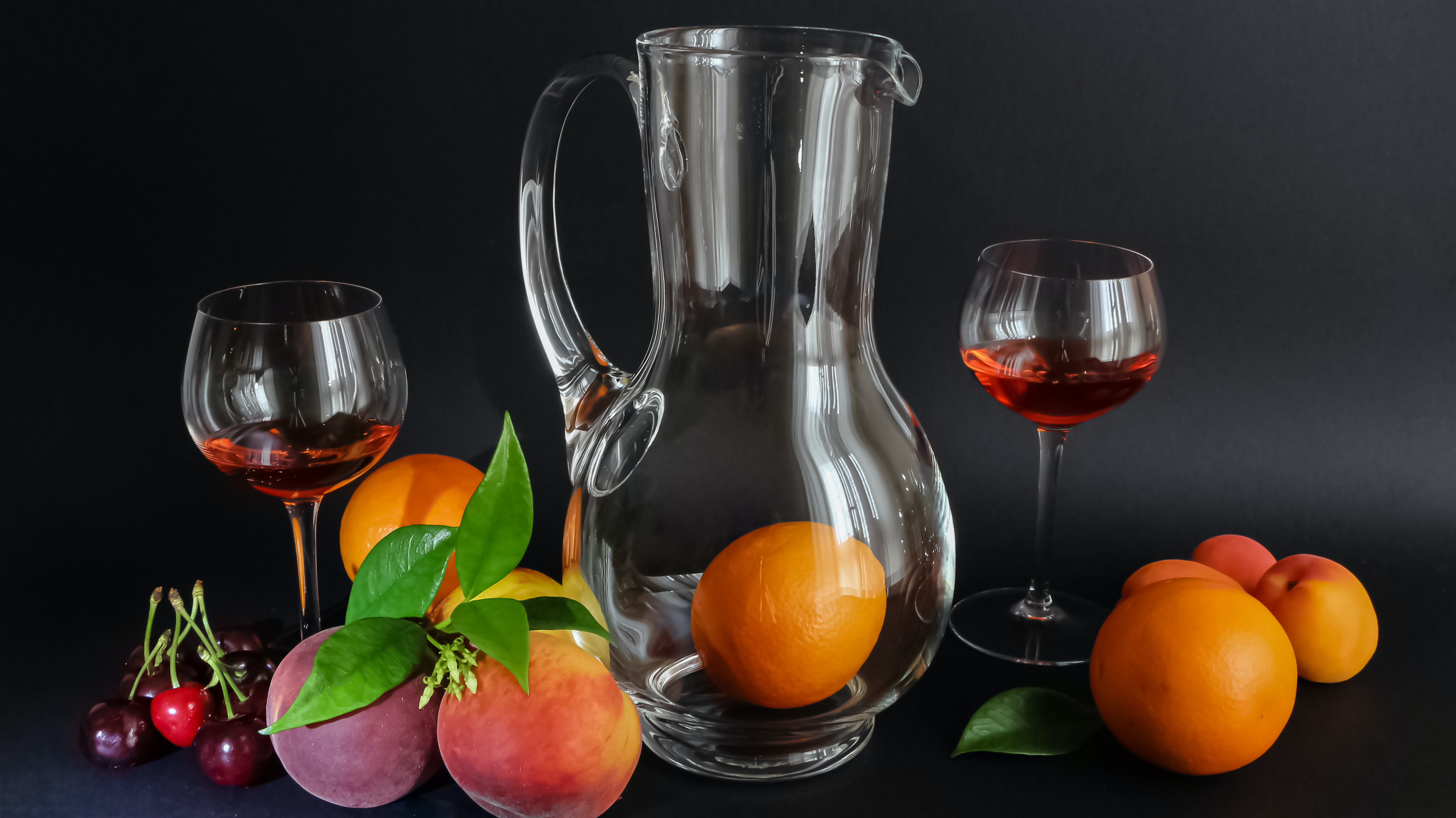 variety of fruits with pitcher