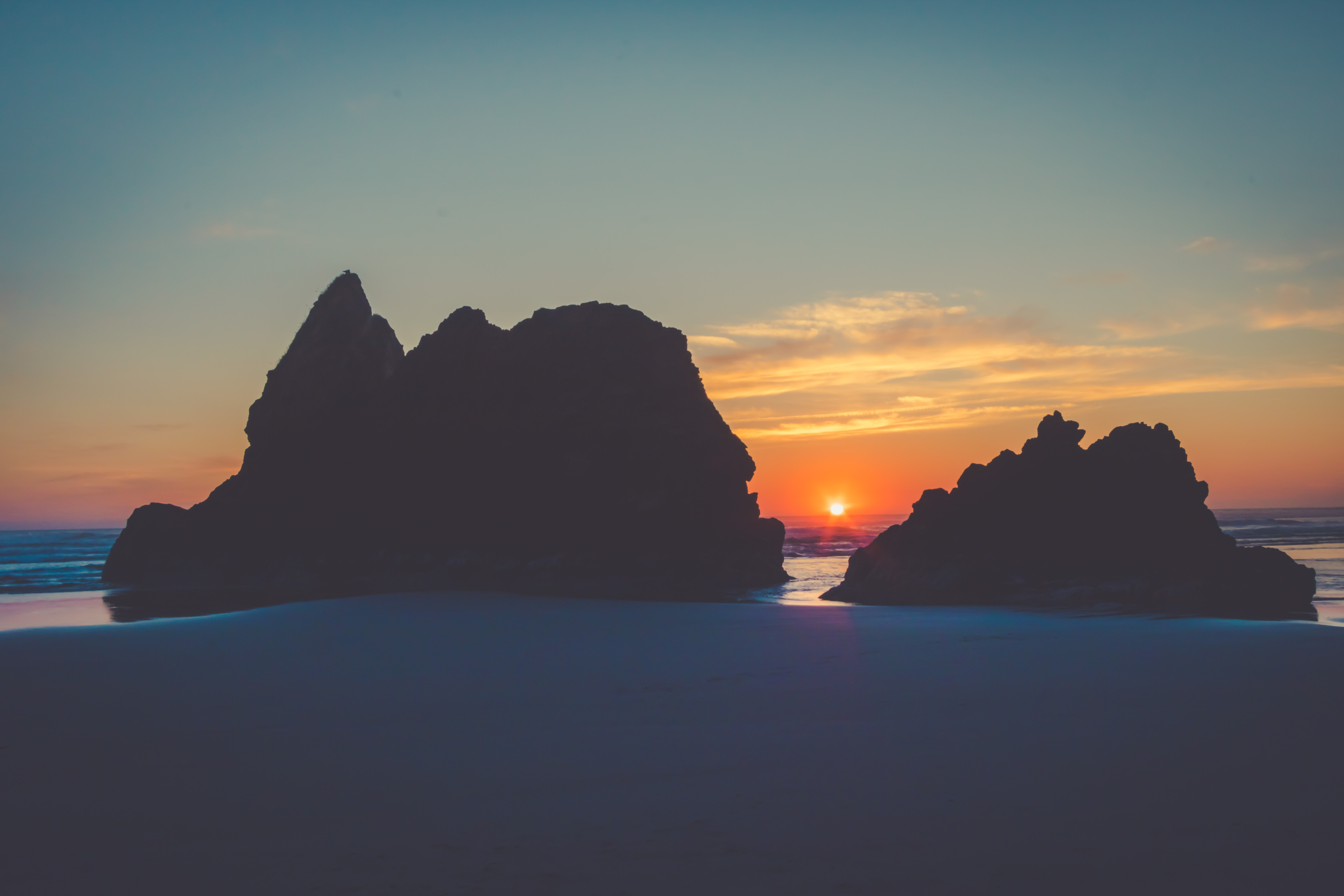 silhouette of island during sunset