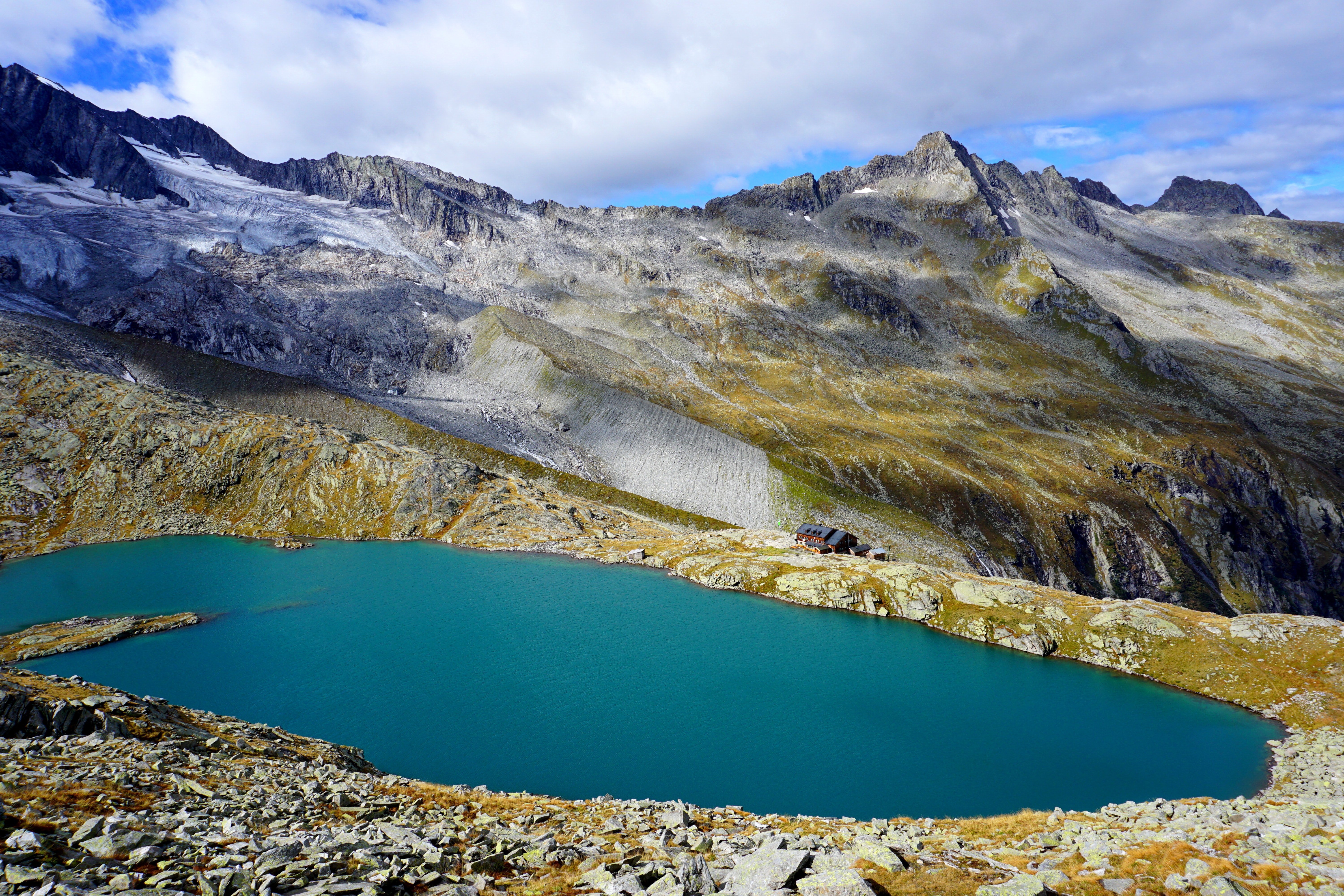 lake surrounded by mountain landscape during daytime