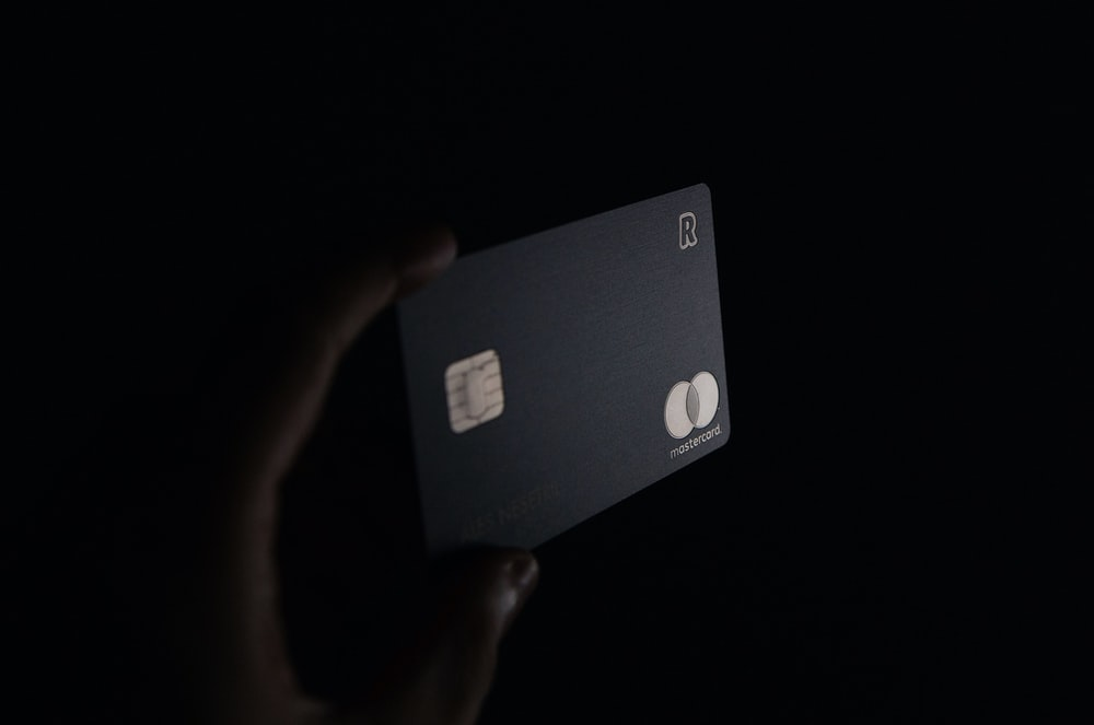person holding a black card