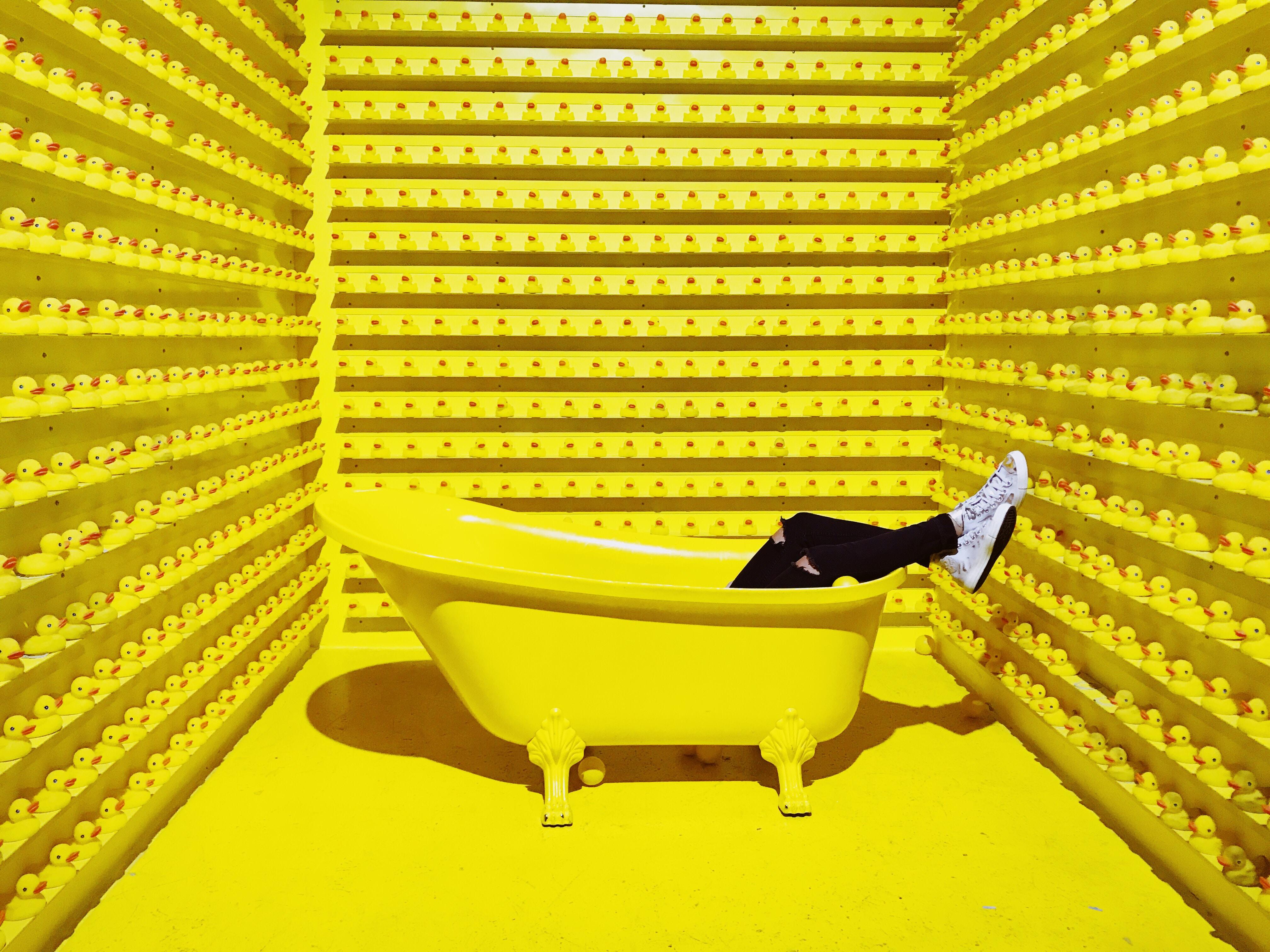 person in white claw foot bathtub