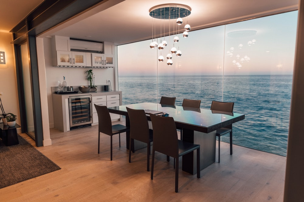 dining table set placed beside glass window