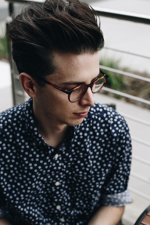 man wearing black and white polka-dot sport shirt