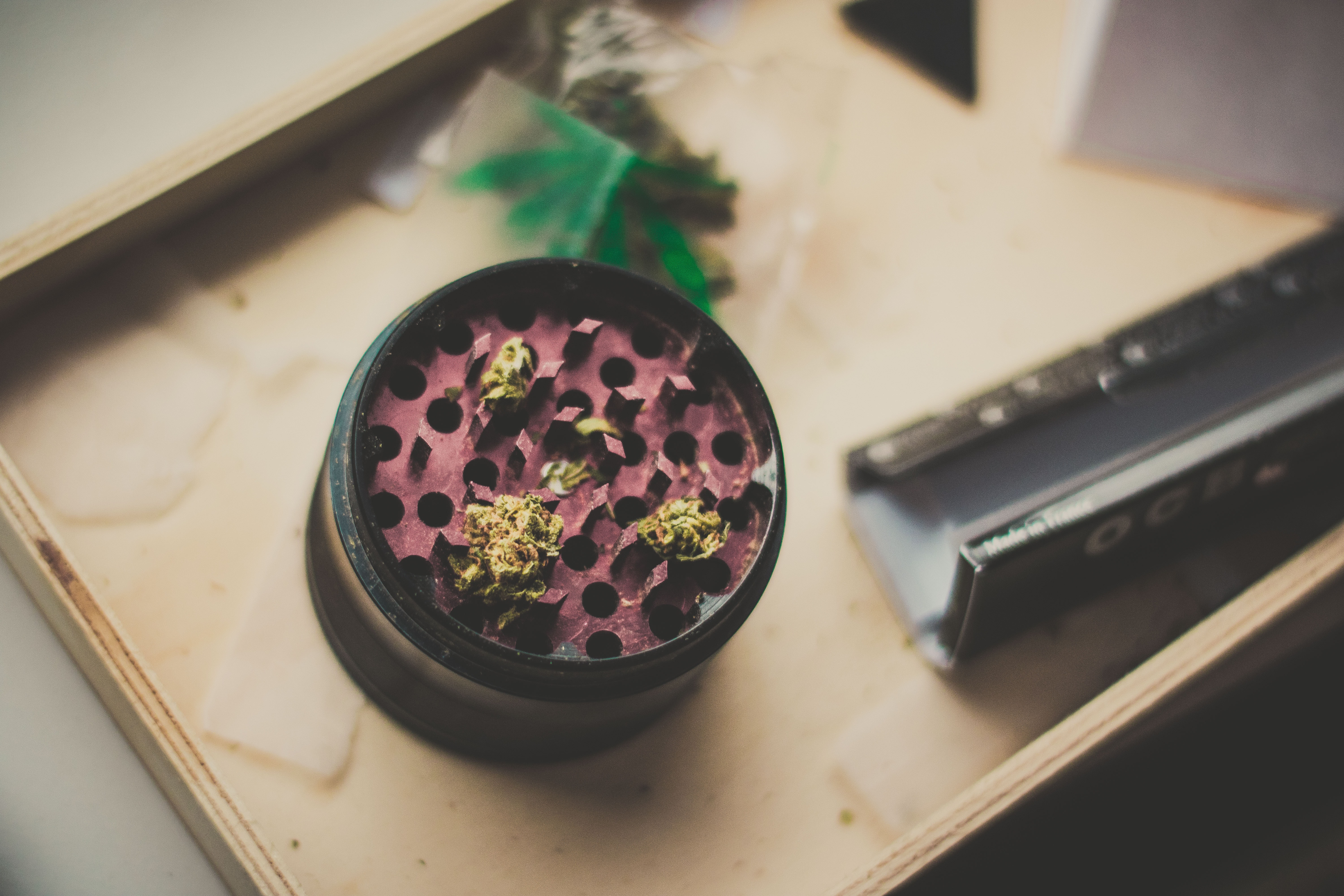 red and black herb grinder