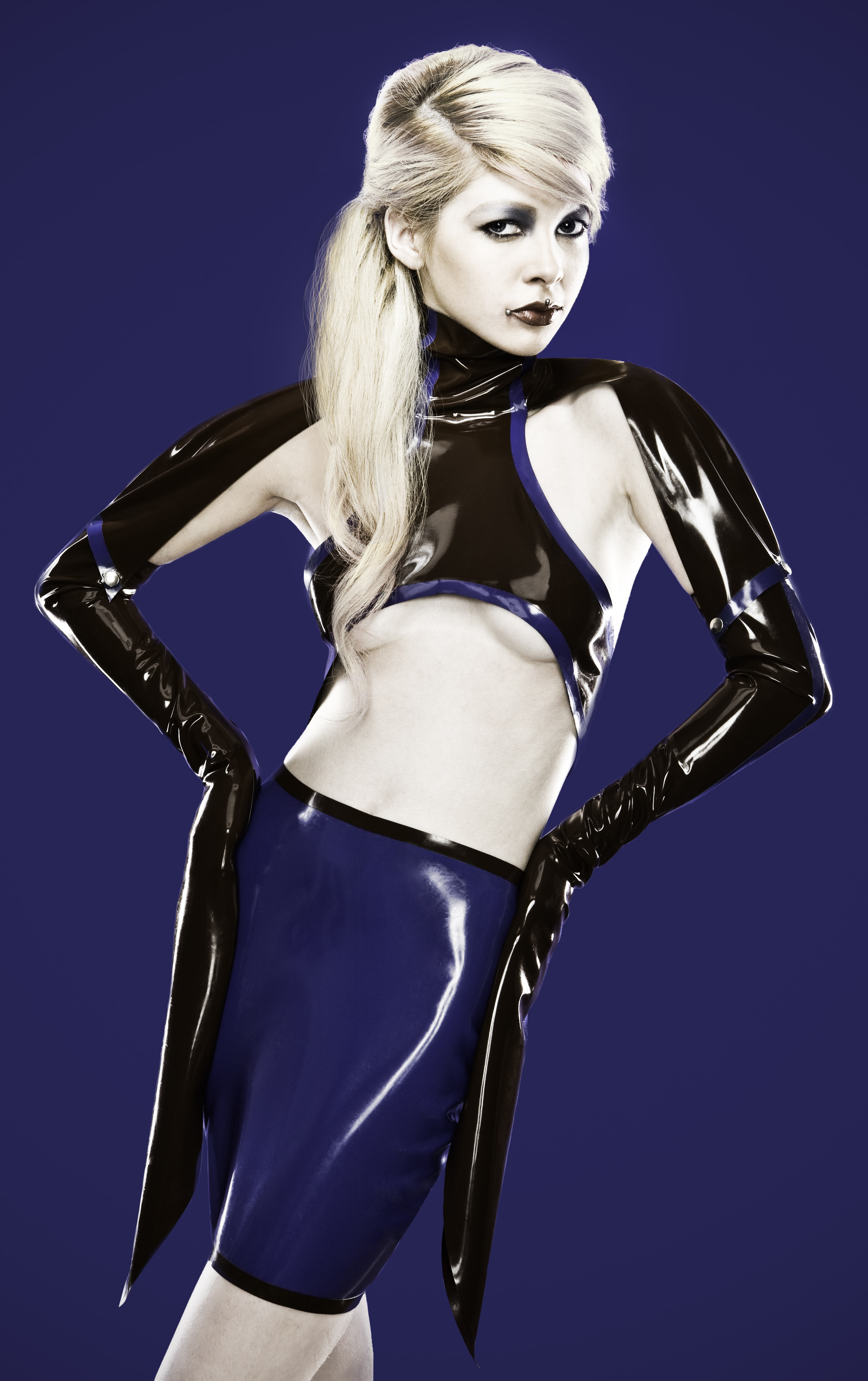 woman wearing black leather top and blue skirt
