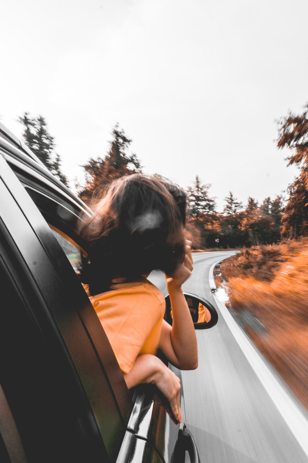 woman looking out vehicle window