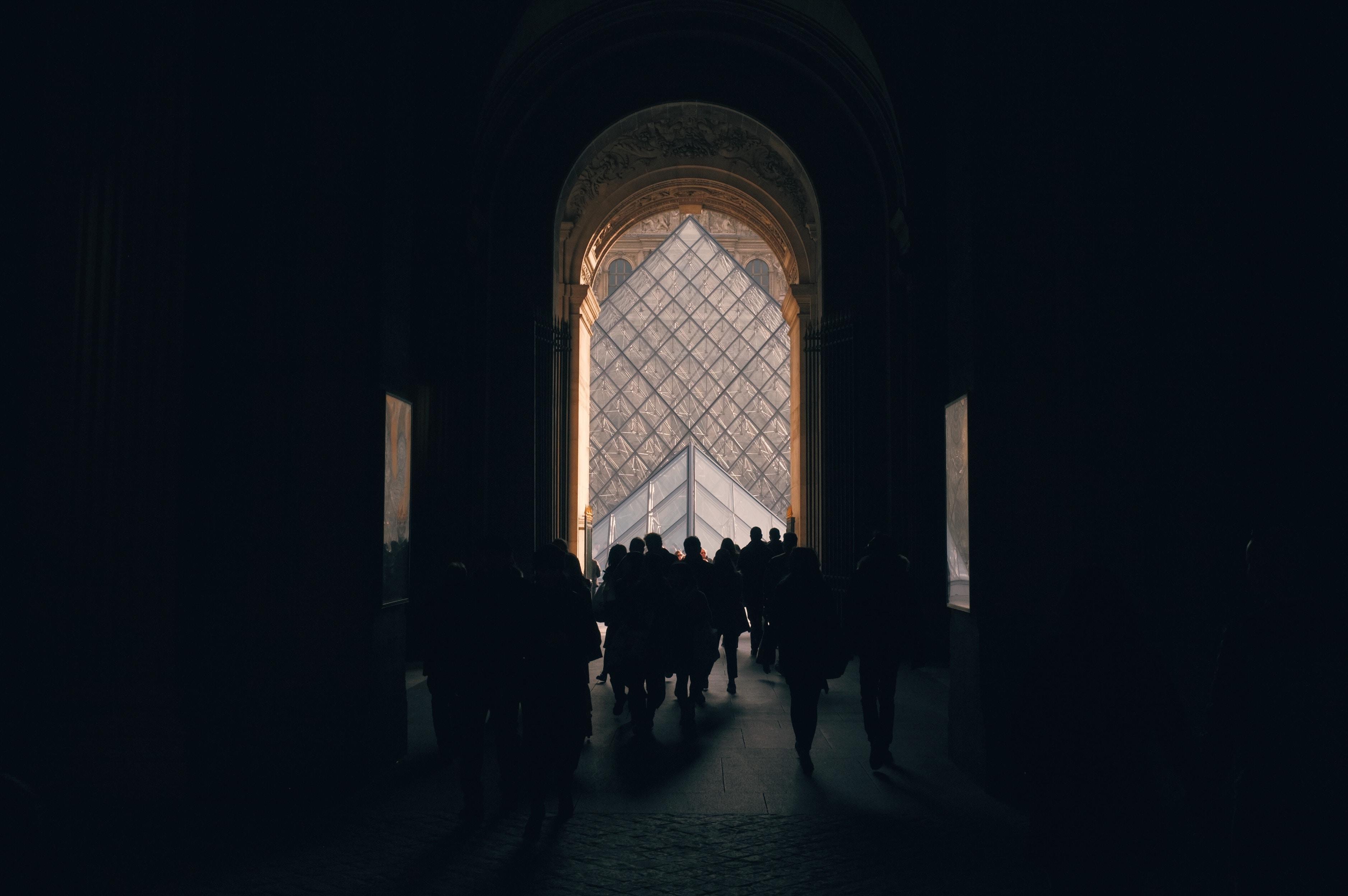 silhouette of people standing indoors