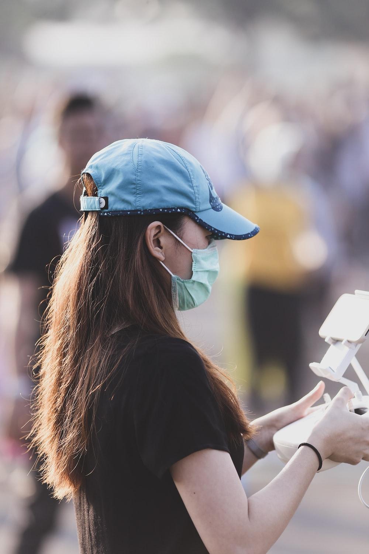 woman holding radio controller
