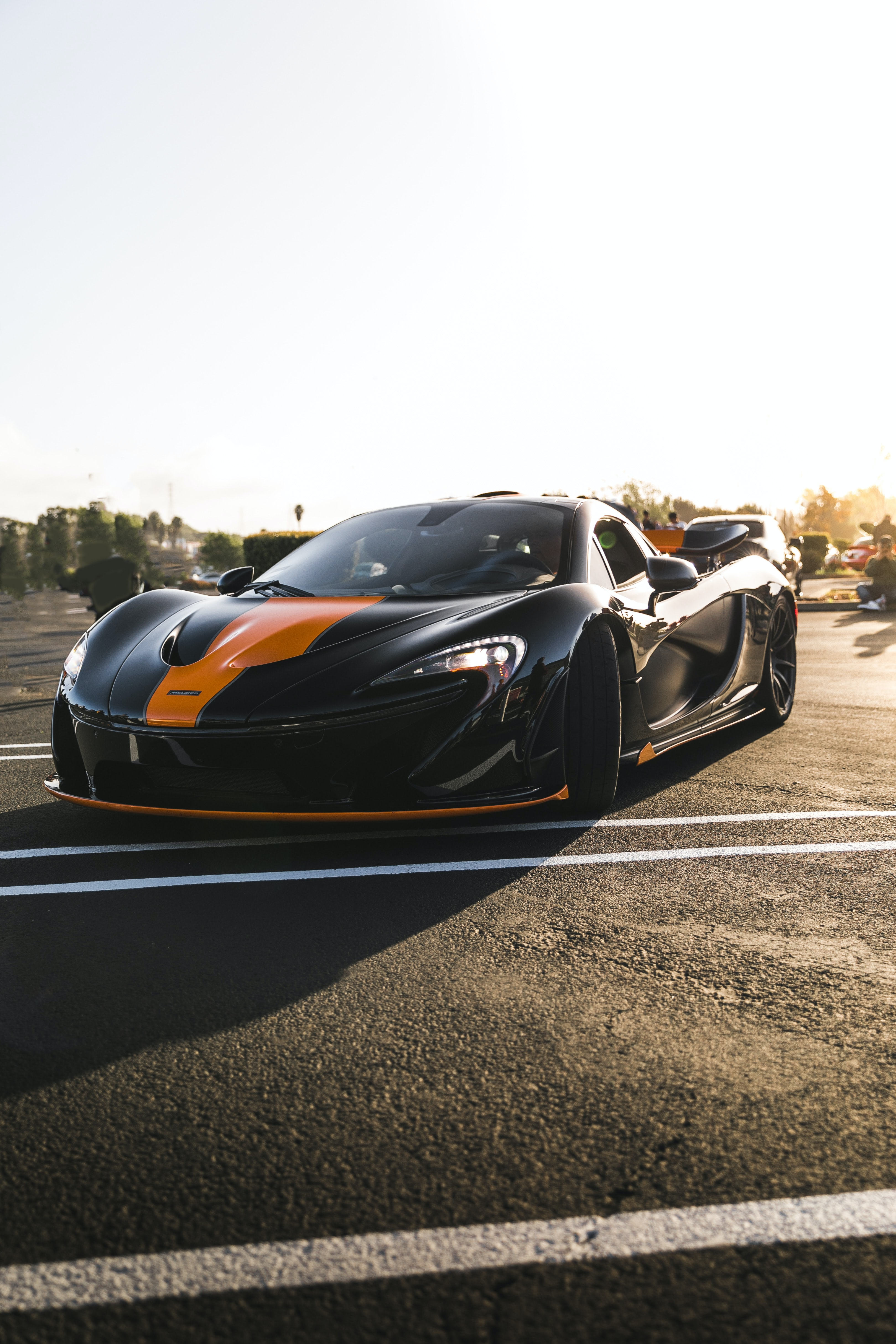 black and orange sports car under clear sky during daytime
