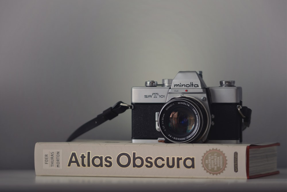gray Minolta camera on book