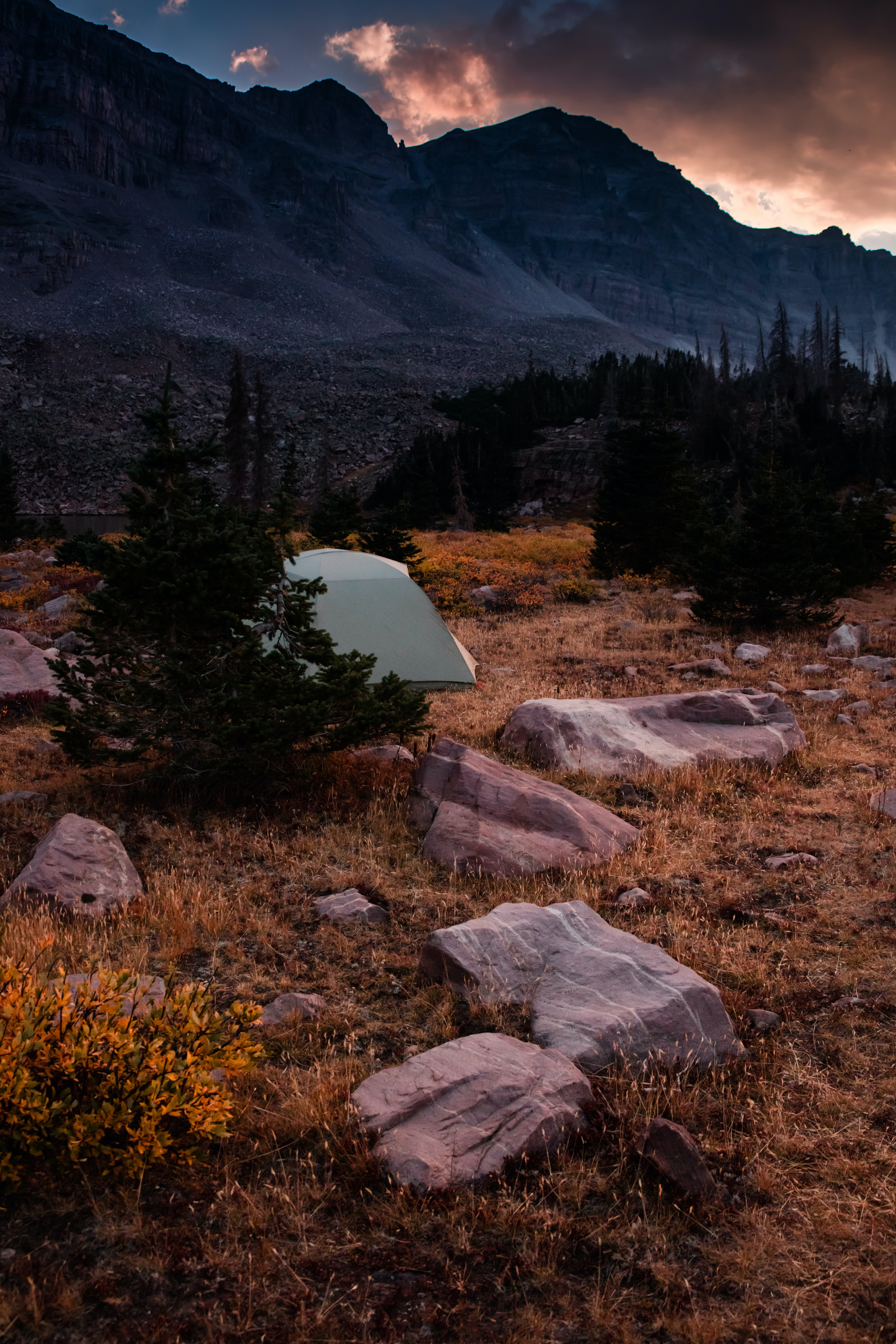 white camping tent near mountain during daytime