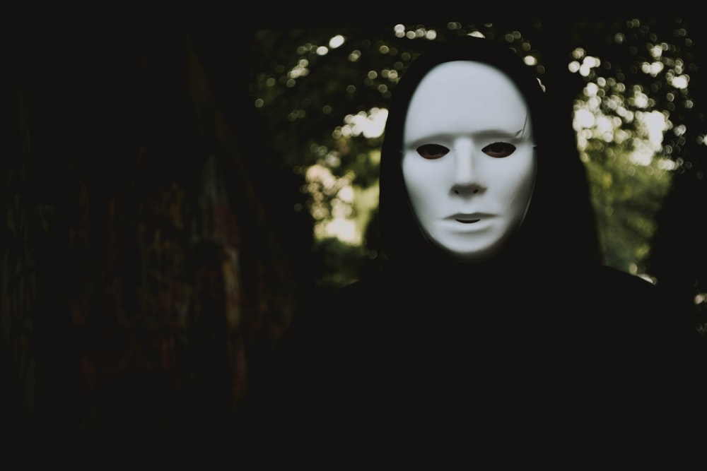 man wearing white face mask